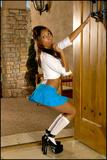 Busty Priya Rai dressed as naughty schoolgirl - picture no. 1